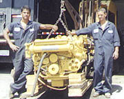 CAT Technicians Van and Ron display a repowered CAT 3208 Marine Engine
