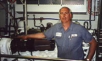 Boston Fuel Injection owner Sal Salvato stands next to a serviced CAT 3412E